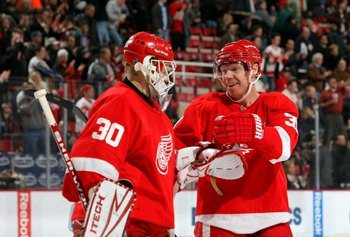 DETROIT - FEBRUARY 4:  Goaltender Chris Osgood #30 and Kris Draper #33 of the Detroit Red Wings celebrate after the NHL game against the Phoenix Coyotes at Joe Louis Arena on February 4, 2009 in Detroit, Michigan. The Red Wings defeated the Coyotes 5-4.
