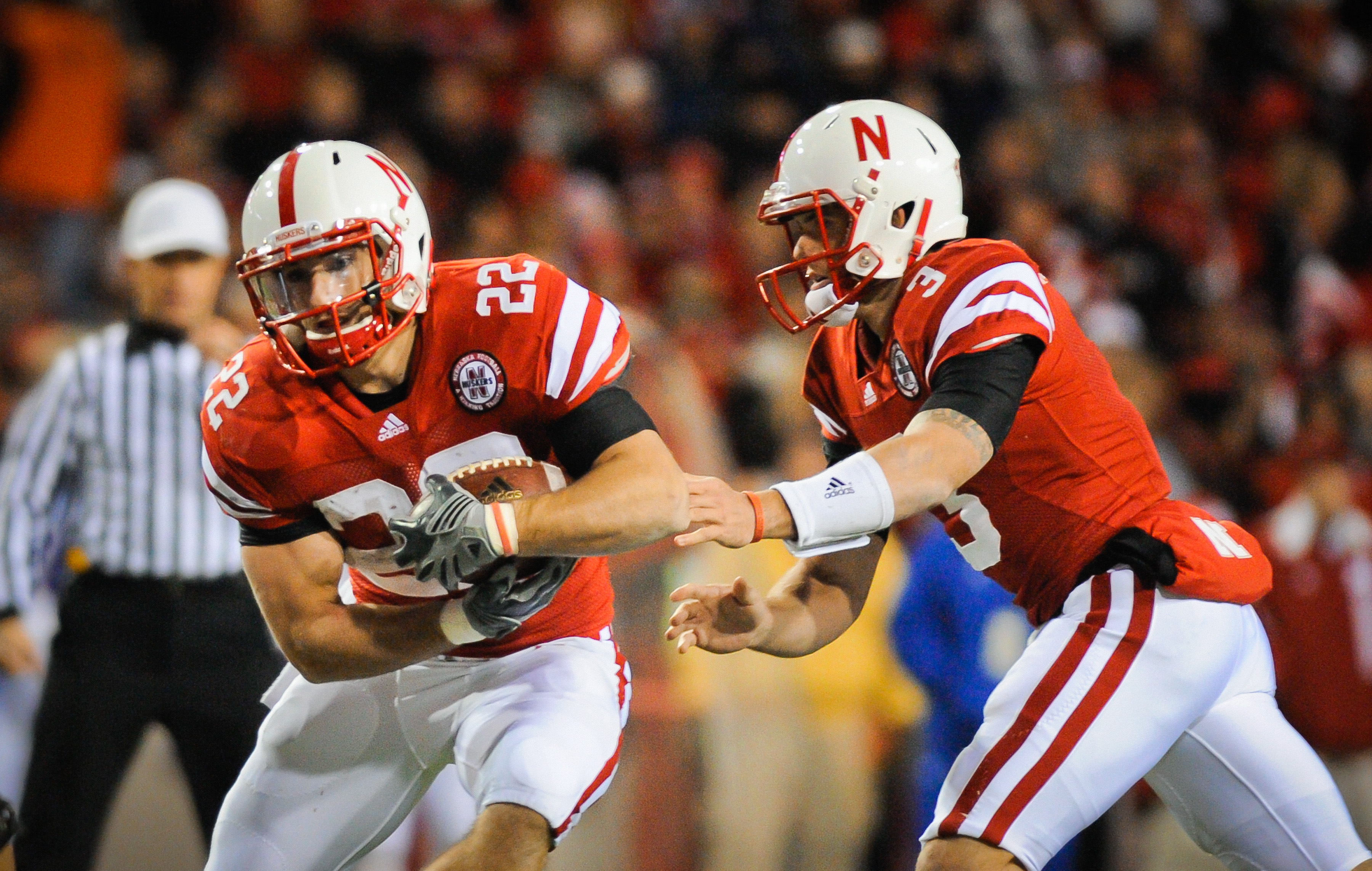 LINCOLN, NE - NOVEMBER 13: Taylor Martinez #3 of the Nebraska Cornhuskers hands the ball to Rex Burkhead #22 during second half action of their game at Memorial Stadium on November 13, 2010 in Lincoln, Nebraska. Nebraska Defeated Kansas 20-3. (Photo by Er