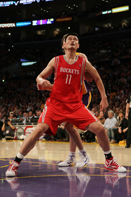 LOS ANGELES, CA - OCTOBER 26:  Yao Ming #11 of the Houston Rockets looks to rebound during their opening night game against the Los Angeles Lakers at Staples Center on October 26, 2010 in Los Angeles, California. NOTE TO USER: User expressly acknowledges