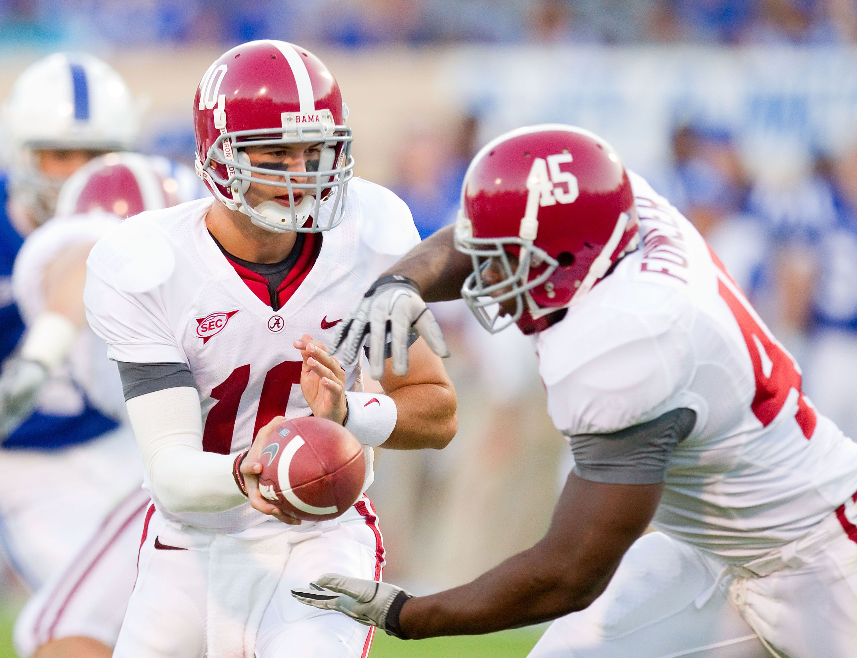 DURHAM, NC - SEPTEMBER 18: A.J. McCarron #10 of the Alabama Crimson Tide hands the ball off to Jalston Fowler #45 during fourth quarter action against the Duke Blue Devils at Wallace Wade Stadium on September 18, 2010 in Durham, North Carolina.  The Crims