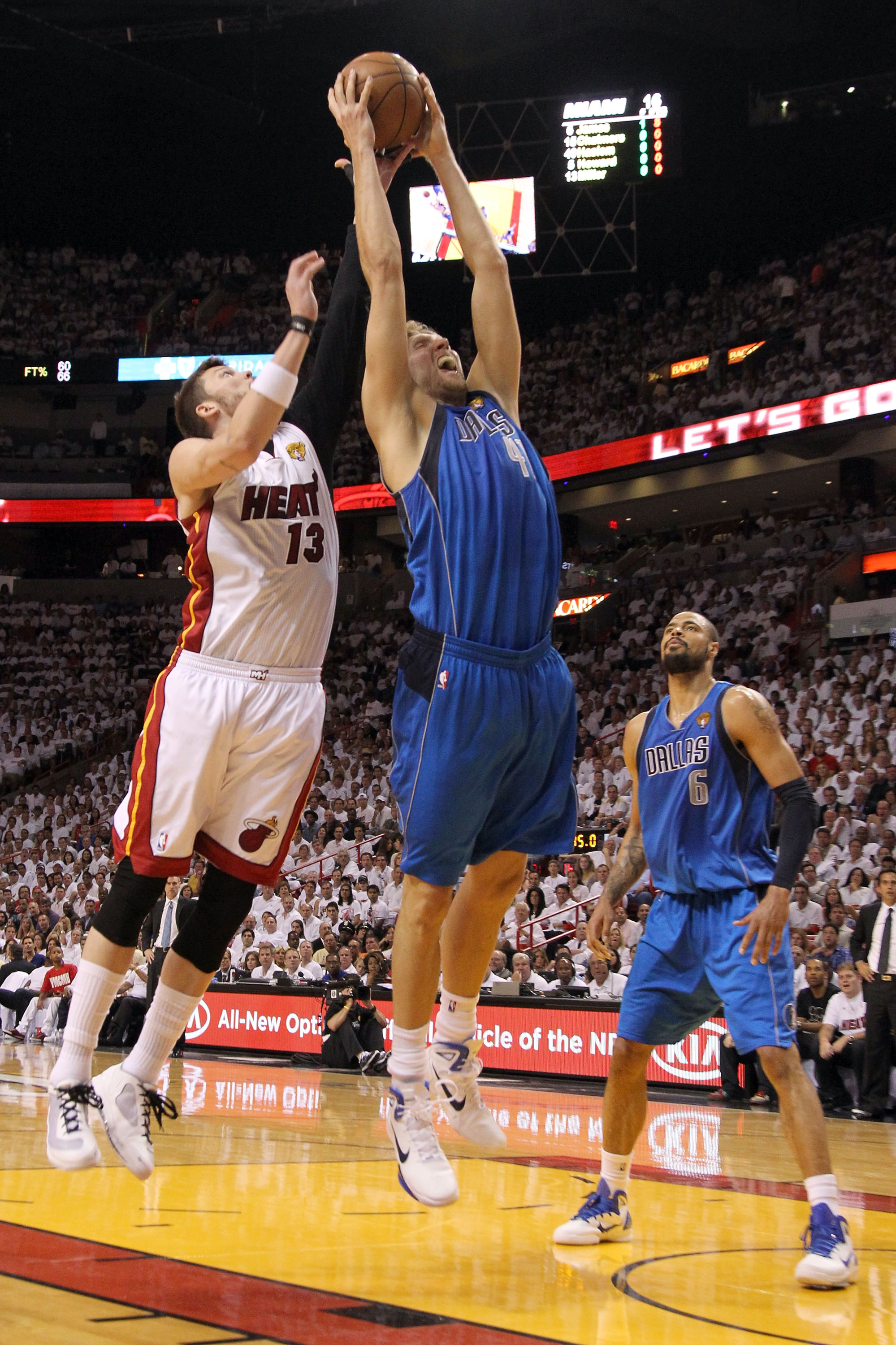 MIAMI, FL - MAY 31:  Dirk Nowitzki #41 of the Dallas Mavericks grabs a rebound against Mike Miller #13 of the Miami Heat in Game One of the 2011 NBA Finals at American Airlines Arena on May 31, 2011 in Miami, Florida. NOTE TO USER: User expressly acknowle