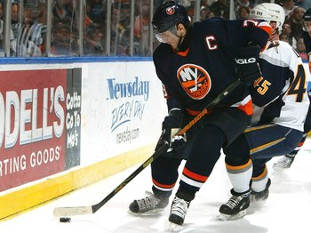 UNIONDALE, NY - APRIL 18:  Alexei Yashin #79 of the New York Islanders skates with the puck during Game 4 of the 2007 Eastern Conference Quarterfinals against  the Buffalo Sabres on April 18, 2007 at Nassau Coliseum in Uniondale, New York.  (Photo by Jim