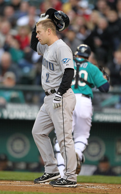 SEATTLE - APRIL 11:  Aaron Hill #2 of the Toronto Blue Jays is called out on strikes in the first inning against the Seattle Mariners at Safeco Field on April 11, 2011 in Seattle, Washington. (Photo by Otto Greule Jr/Getty Images)
