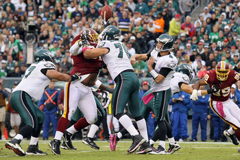 PHILADELPHIA - OCTOBER 03:  Kevin Kolb #4 of the Philadelphia Eagles has a pass blocked in the first half against the Washington Redskins on October 3, 2010 at Lincoln Financial Field in Philadelphia, Pennsylvania.  (Photo by Jim McIsaac/Getty Images)