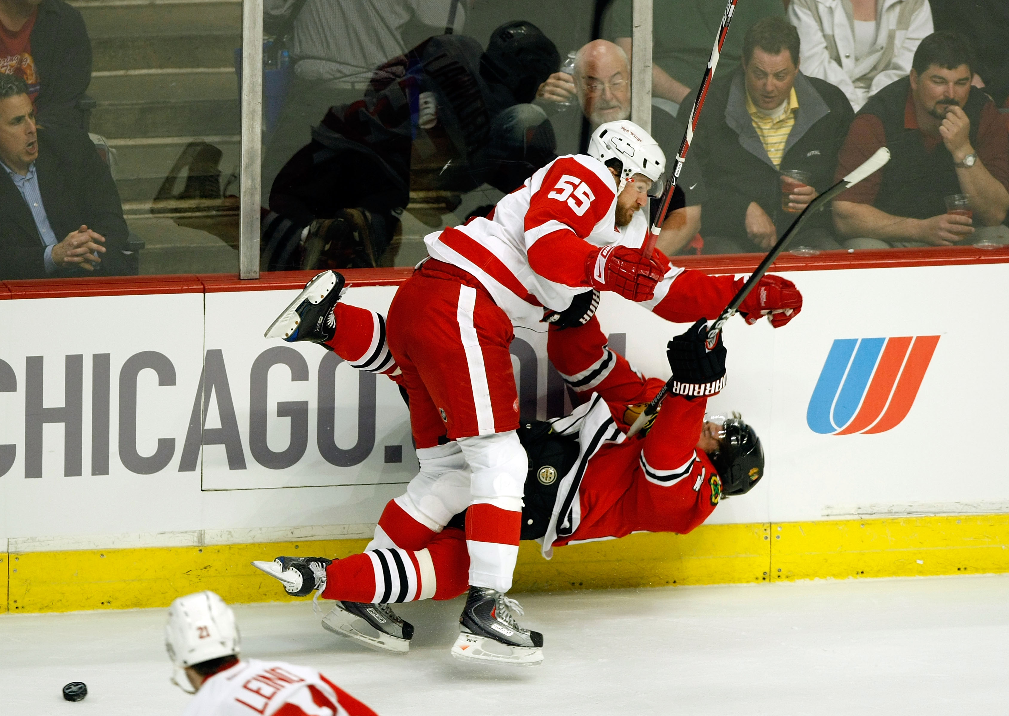 CHICAGO - MAY 22:  Martin Havlat #24 of the Chicago Blackhawks checked hard to the ice by Niklas Kronwall #55 of the Detroit Red Wings during the first period of Game Three of the Western Conference Championship Round of the 2009 Stanley Cup Playoffs on M
