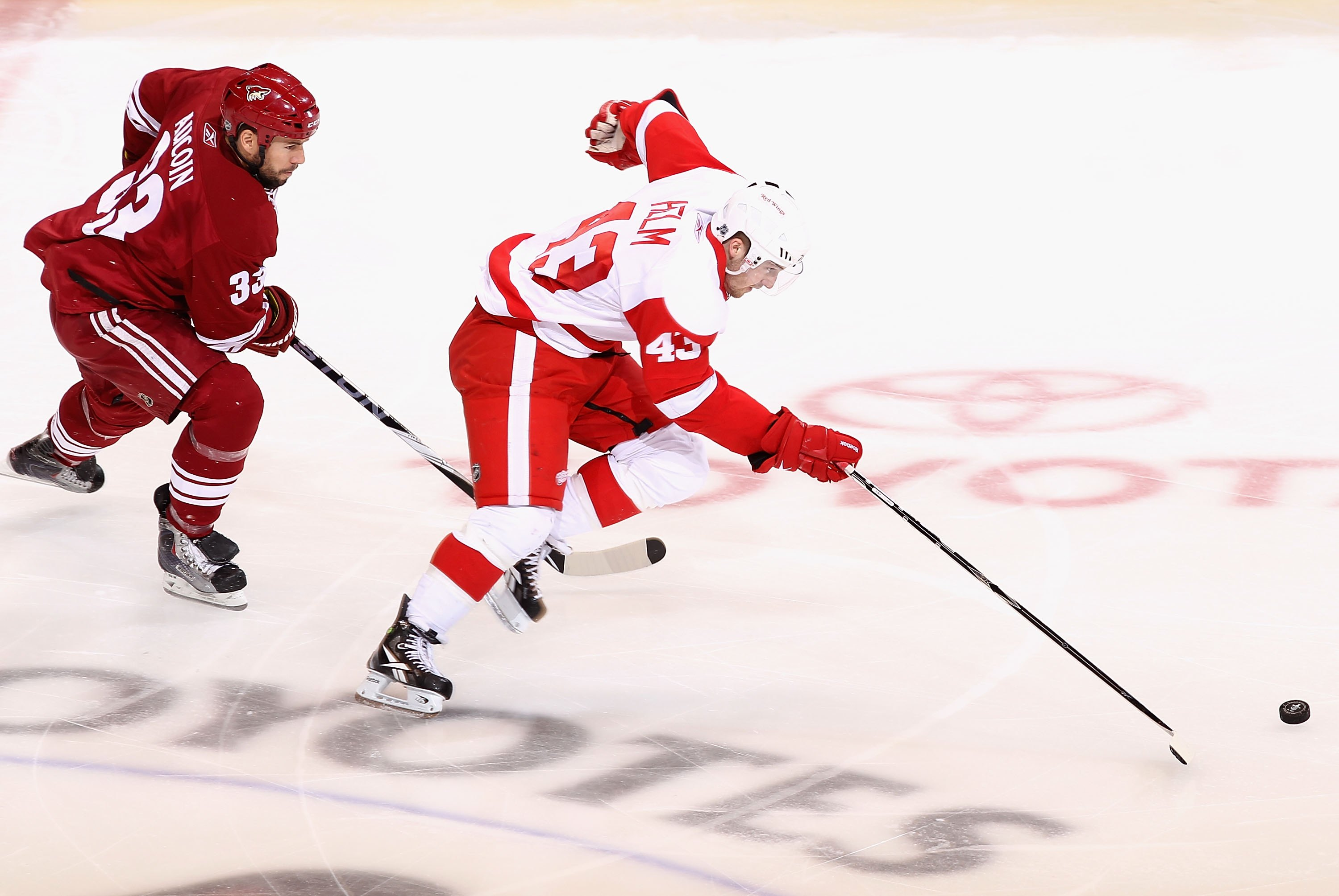 GLENDALE, AZ - APRIL 27:  Darren Helm #43 of the Detroit Red Wings skates with the puck past the Phoenix Coyotes in Game Seven of the Western Conference Quarterfinals during the 2010 NHL Stanley Cup Playoffs at Jobing.com Arena on April 27, 2010 in Glenda
