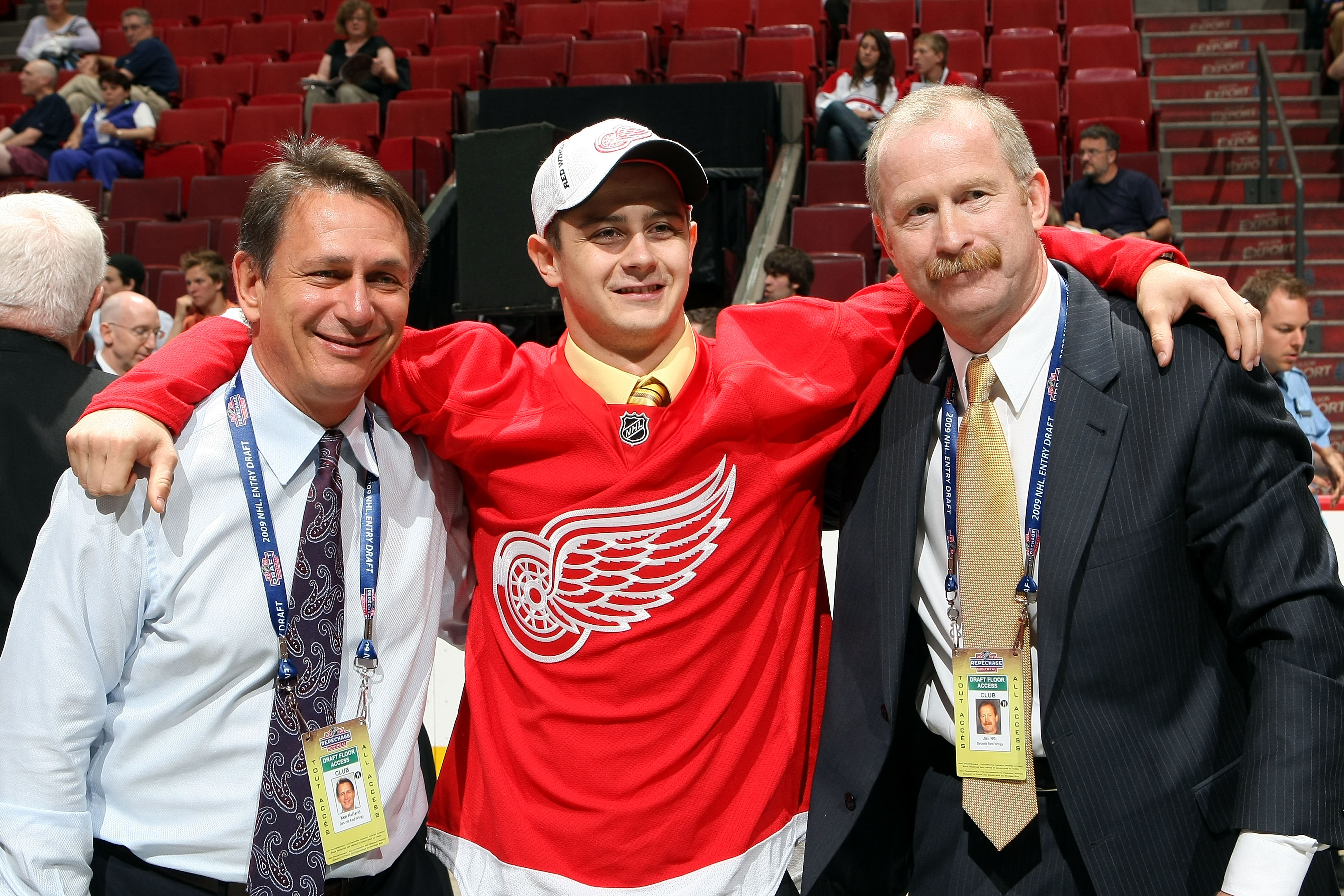 MONTREAL, QC - JUNE 27:  Vice President and Assistant General Manager Jim Nill (R) and Executive Vice President, General Manager and Alternate Governor Ken Holland (L) of the Detroit Red Wings pose for a photo with Tomas Tatar (C) after the Wings drafted
