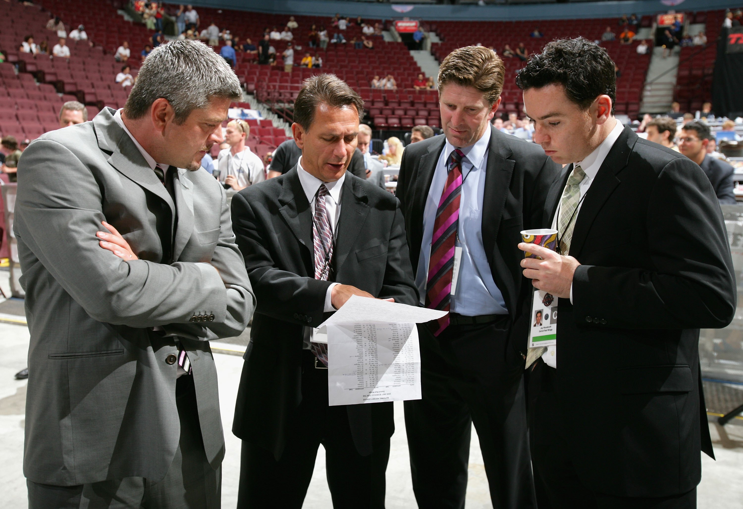 VANCOUVER, BC - JUNE 24:  (L-R) Assistant coach Todd McLellan, general manager Ken Holland, head coach Mike Babcock, and video coach Jay Woodcroft of the Detroit Red Wings convene during the 2006 NHL Draft held at General Motors Place on June 24, 2006 in