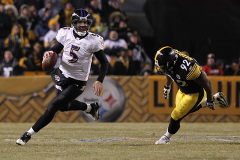 PITTSBURGH, PA - JANUARY 15:  Quarterback Joe Flacco #5 of the Baltimore Ravens runs with the ball as linebacker James Harrison #92 of the Pittsburgh Steelers chases him in the AFC Divisional Playoff Game at Heinz Field on January 15, 2011 in Pittsburgh,