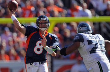 DENVER - SEPTEMBER 19:  Quarterback Kyle Orton #8 of the Denver Broncos gets off a pass while under pressure from defensive end Red Bryant #79 of the Seattle Seahawks at INVESCO Field at Mile High on September 19, 2010 in Denver, Colorado. The Broncos def