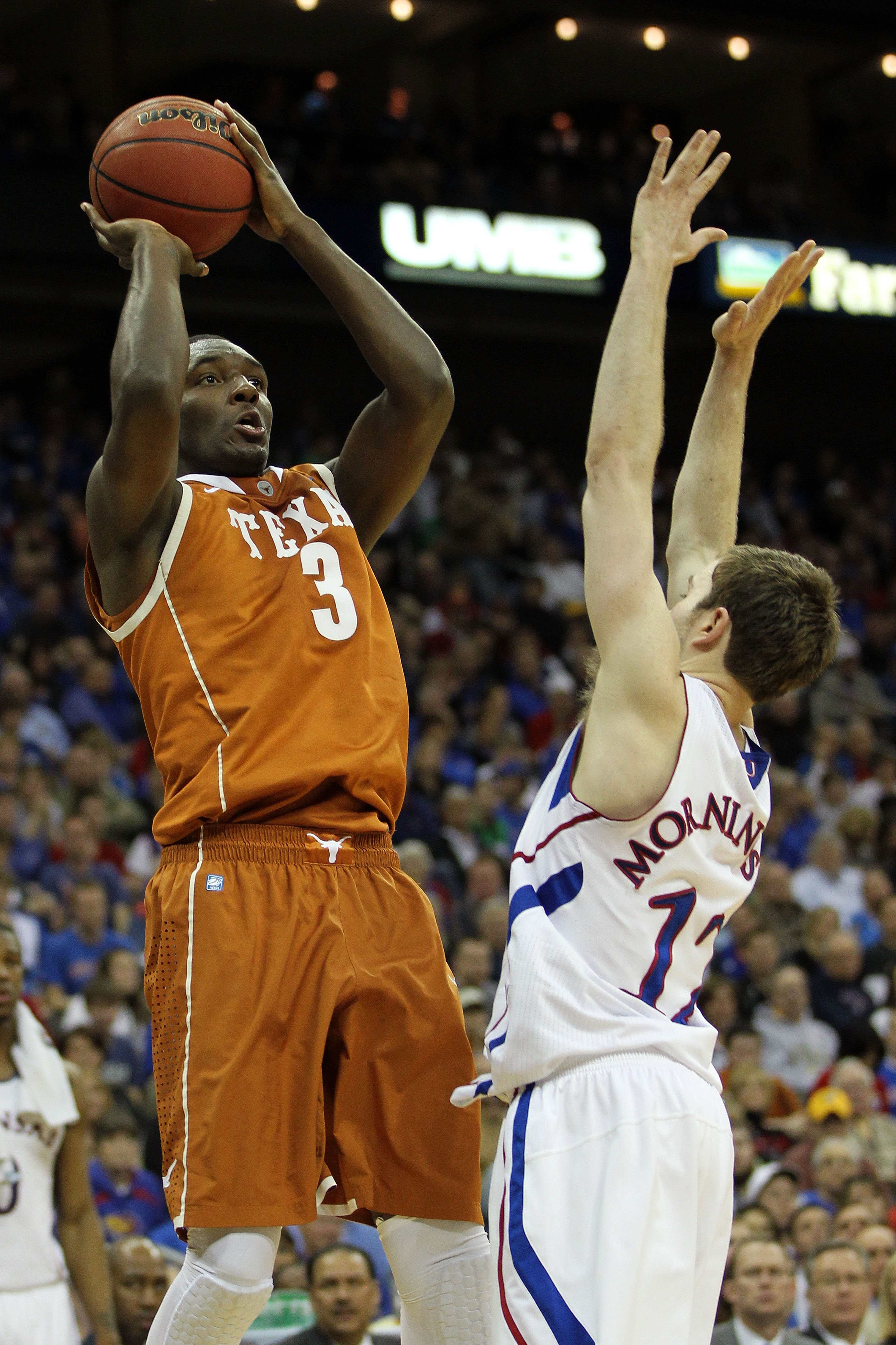 KANSAS CITY, MO - MARCH 12:  Jordan Hamilton #3 of the Texas Longhorns goes up for a shot against Brady Morningstar #12 of the Kansas Jayhawks during the 2011 Phillips 66 Big 12 Men's Basketball Tournament championship game at Sprint Center on March 12, 2