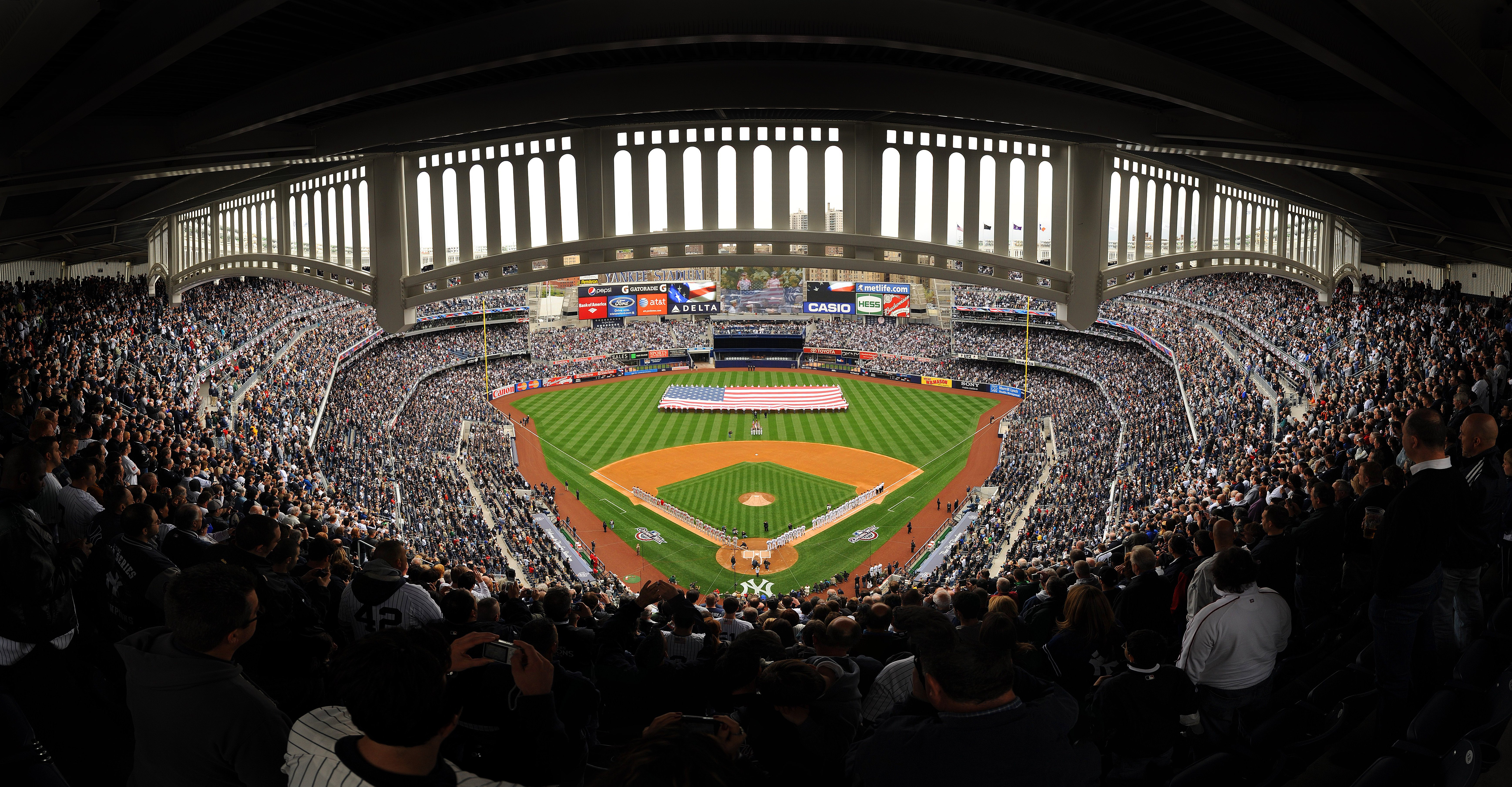 NEW YORK - APRIL 13: (***EDITORS NOTE*** THIS PANORAMIC COMPOSITE IMAGE WAS CREATED USING PHOTO STITCHING SOFTWARE) The New York Yankees and the Los Angeles Angels of Anaheim stand at attention during the National Anthem as a giant American flag is displa