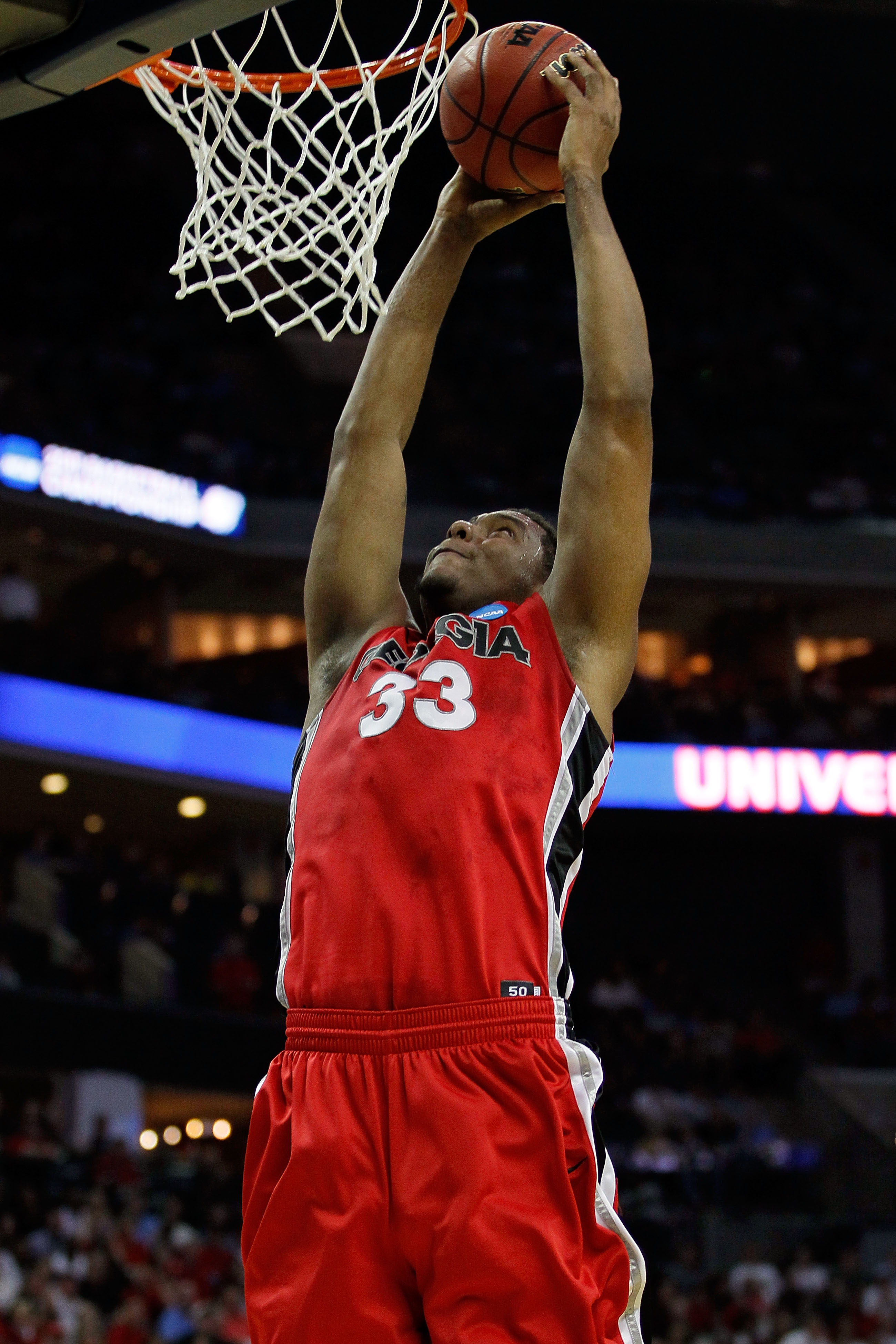 CHARLOTTE, NC - MARCH 18:  Trey Thompkins #33 of the Georgia Bulldogs dunks the ball in the first half while taking on the Washington Huskies during the second round of the 2011 NCAA men's basketball tournament at Time Warner Cable Arena on March 18, 2011