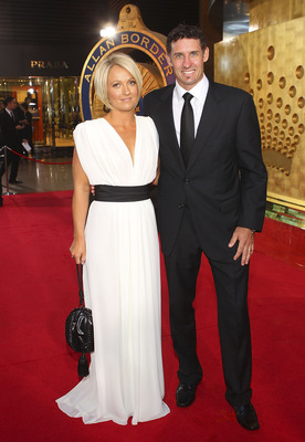 MELBOURNE, AUSTRALIA - FEBRUARY 07:  Mike Hussey and Amy Hussey arrive at the Allan Border Medal held at Crown Palladium on February 7, 2011 in Melbourne, Australia.  (Photo by Lucas Dawson/Getty Images)