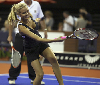ADELAIDE, AUSTRALIA - DECEMBER 01:  Lara Bingle takes part in the Gerard McCabe Jewellers Celebrity Tennis Challenge at the Adelaide Entertainment Centre on December 1, 2007 in Adelaide, Australia. The event, now in its 14th year, aims to raise funds to b