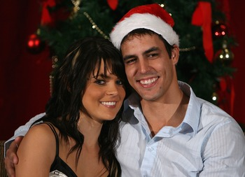 MELBOURNE, AUSTRALIA - DECEMBER 25:  Mitchell Johnson and partner Jess Bratich pose for photos during the Australian cricket team Christmas lunch at Crown Casino on December 25, 2007 in Melbourne, Australia.  (Photo by Robert Prezioso/Getty Images)