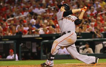 Freddy Sanchez watches his three-run homer soar down the left field line