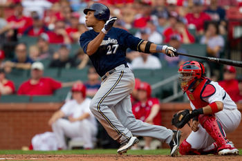 ST. LOUIS, MO - MAY 7: Carlos Gomez #27 of the Milwaukee Brewers hits a two RBI triple against the St. Louis Cardinals at Busch Stadium on May 7, 2011 in St. Louis, Missouri.  (Photo by Dilip Vishwanat/Getty Images)