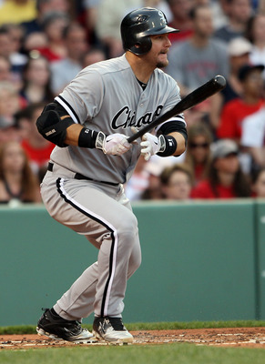 BOSTON, MA - MAY 30:  A.J. Pierzynski #12 of the Chicago White Sox hits a 2RBI single in the first inning against the Boston Red Sox on May 30, 2011 at Fenway Park in Boston, Massachusetts.  (Photo by Elsa/Getty Images)
