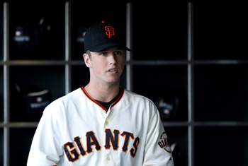 SAN FRANCISCO - JULY 15:  Buster Posey #28 of the San Francisco Giants stands in the dugout before their game against the New York Mets at AT&T Park on July 15, 2010 in San Francisco, California.  (Photo by Ezra Shaw/Getty Images)