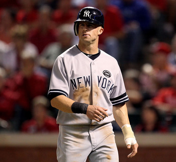 ARLINGTON, TX - OCTOBER 15:  Brett Gardner #11 of the New York Yankees looks on after he scored on a RBI double by Derek Jeter #2 in the top of the eighth inning against the Texas Rangers in Game One of the ALCS during the 2010 MLB Playoffs at Rangers Bal