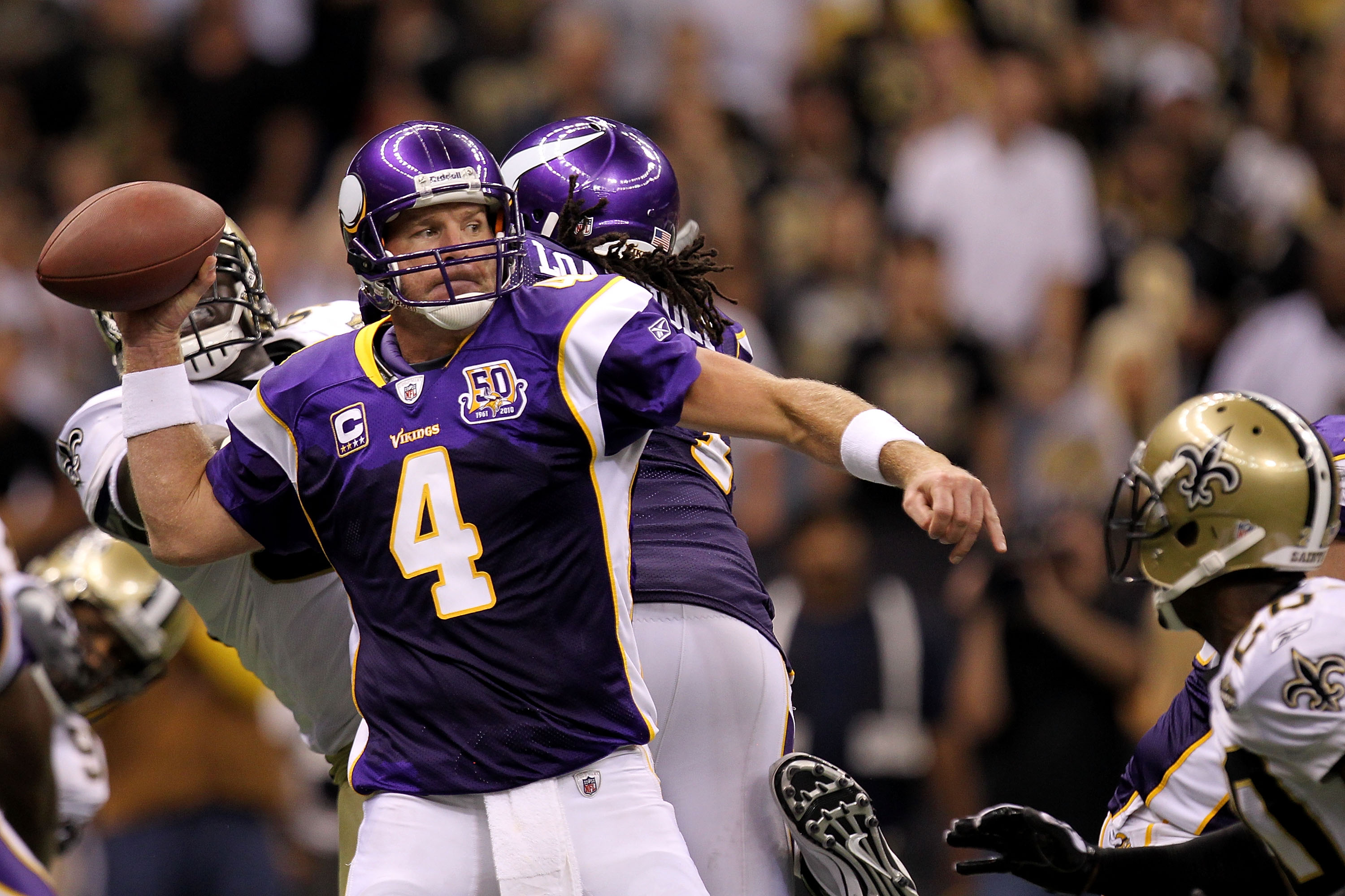 NEW ORLEANS - SEPTEMBER 09:  Quarterback Brett Favre #4 of the Minnesota Vikings throws a pass in the fourth quarter against the New Orleans Saints at Louisiana Superdome on September 9, 2010 in New Orleans, Louisiana. The Saints won 14-9.  (Photo by Rona