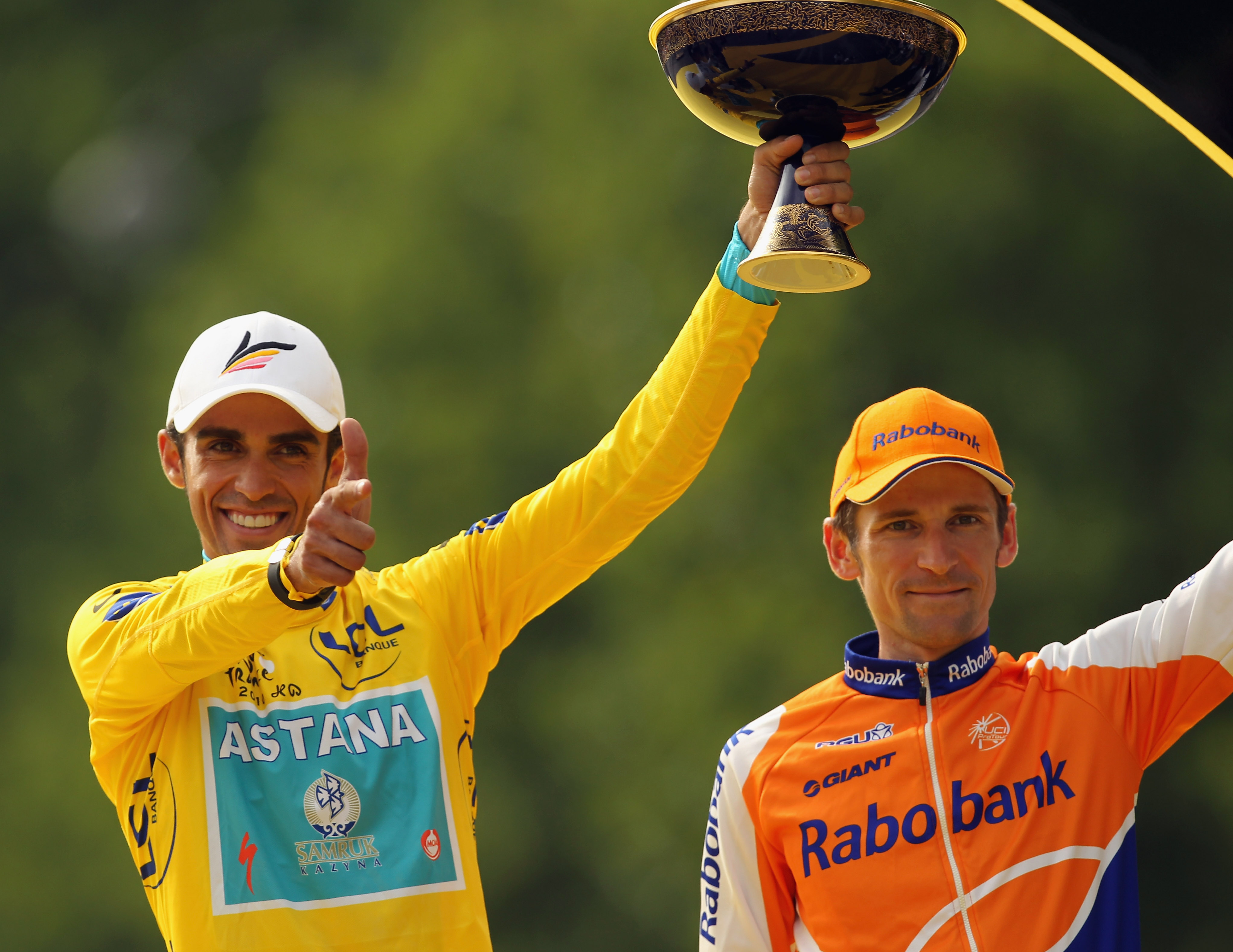 PARIS - JULY 25:  Alberto Contador of team Astana (L) celebrates as Denis Menchov of team Rabobank looks on after the twentieth and final stage of Le Tour de France 2010, from Longjumeau to the Champs-Elysees in Paris on July 25, 2010 in Paris, France.  (