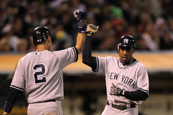 OAKLAND, CA - MAY 31:  Derek Jeter #2 and Curtis Granderson #14 of the New York Yankees congratulate one another after they scored on a single by Alex Rodriguez #13 of the New York Yankees in the sixth inning against the the Oakland Athletics at Oakland-A
