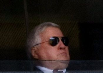 NEW YORK - APRIL 16:  Owner George Steinbrenner looks on from his luxury box during an opening day ceremony at the new Yankee Stadium on April 16, 2009 in the Bronx borough of New York City. This is the first regular season MLB game being played at the ne