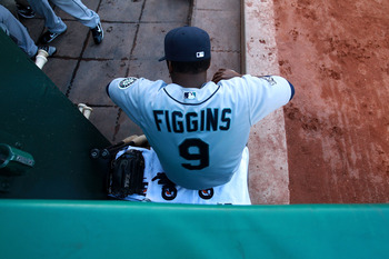 OAKLAND, CA - APRIL 02:  Chone Figgins #9 of the Seattle Mariners looks on prior to his game against the Oakland Athletics during a Major League Baseball game at the Oakland-Alameda County Coliseum on April 2, 2011 in Oakland, California.  (Photo by Jed J