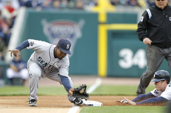 DETROIT - APRIL 28: Chone Figgins #9 of the Seattle Mariners attempts to tag out Brennan Boesch #26 of the Detroit Tigers during the second inning of the  game at Comerica Park on April 28, 2011 in Detroit, Michigan. (Photo by Leon Halip/Getty Images)