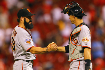 ST. LOUIS, MO - JUNE 1: Brian Wilson #38 and Eli Whiteside #22 of the San Francisco Giants congratulate each other after beating the St. Louis Cardinals in 11 innings at Busch Stadium on June 1, 2011 in St. Louis, Missouri.  (Photo by Dilip Vishwanat/Gett