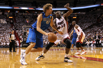 MIAMI, FL - MAY 31:  Dirk Nowitzki #41 of the Dallas Mavericks drives against Joel Anthony #50 of the Miami Heat in Game One of the 2011 NBA Finals at American Airlines Arena on May 31, 2011 in Miami, Florida. NOTE TO USER: User expressly acknowledges and