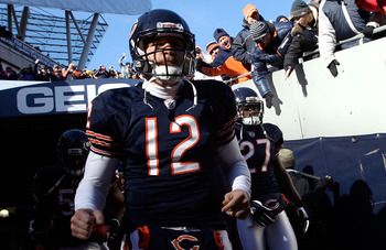 CHICAGO, IL - JANUARY 23:  Caleb Hanie #12 of the Chicago Bears runs out of the tunnel to take on the Green Bay Packers during the NFC Championship Game at Soldier Field on January 23, 2011 in Chicago, Illinois.  (Photo by Jamie Squire/Getty Images)