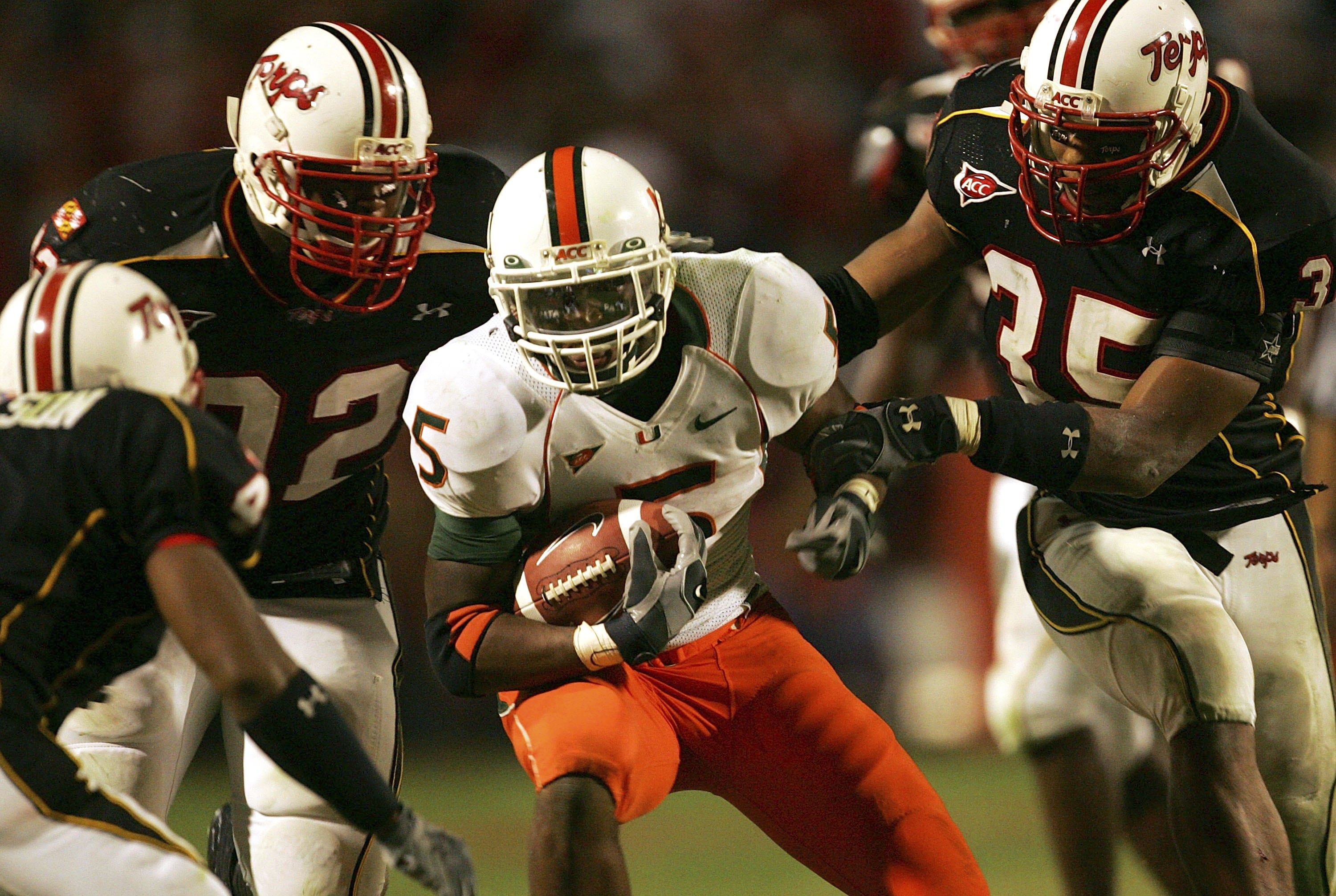 COLLEGE PARK, MD - NOVEMBER 11:  Javarris James #5 of the Miami Hurricanes carries the ball as the Maryland Terrapins defend during the game on November 11, 2006 at Byrd Stadium in College Park, Maryland.  (Photo by Jamie Squire/Getty Images)