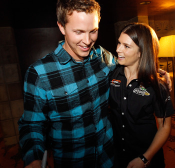 PHOENIX, AZ - FEBRUARY 24:  53rd Daytona 500 champion Trevor Bayne gis congratulated by NASCAR driver Danica Patrick February 24, 2011 in Phoenix, Arizona. Bayne and Patrick made a special appearance at Phoenix International Raceway's annual 'Night of Cha