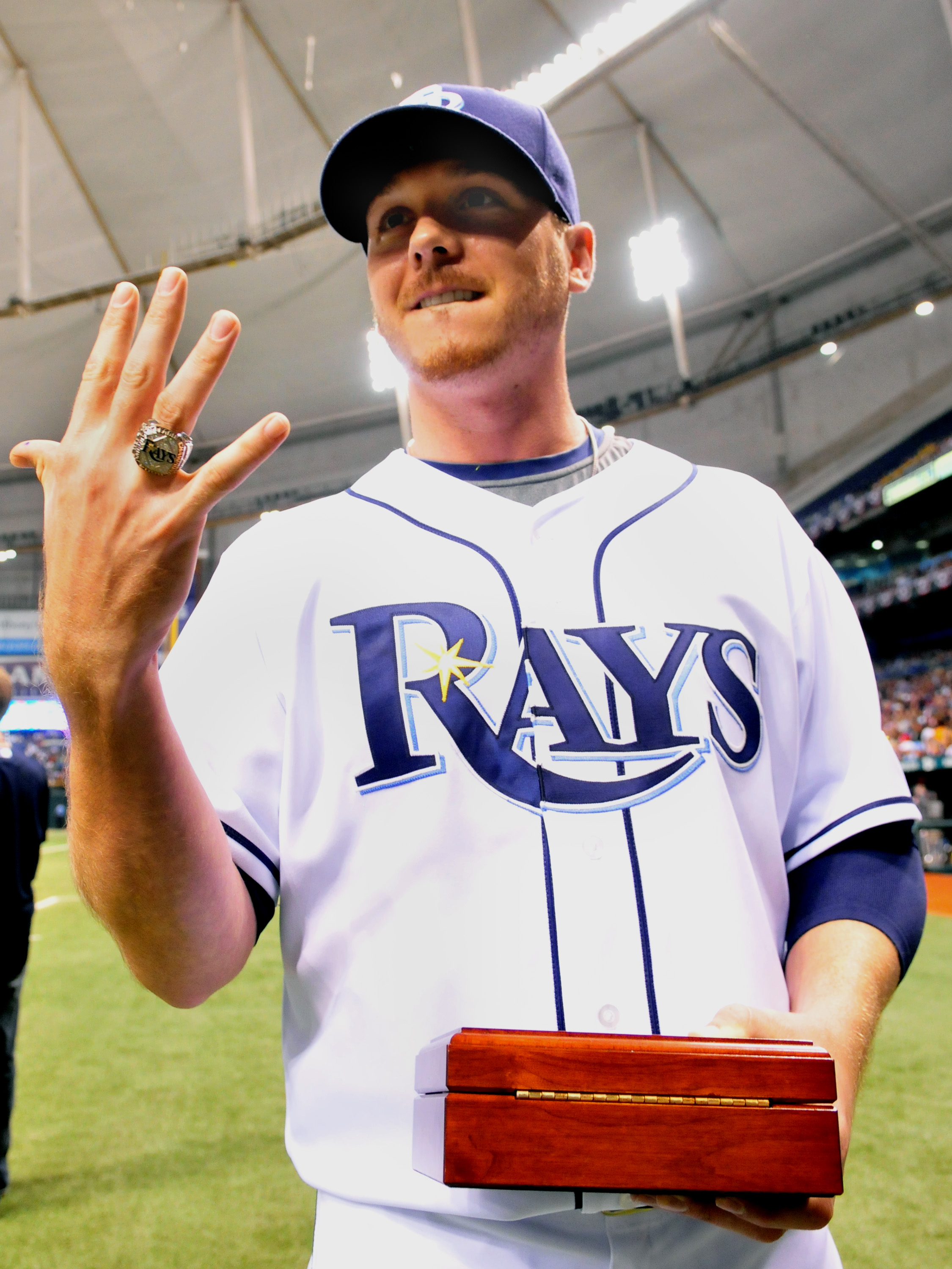 ST. PETERSBURG, FL - APRIL 14:  Pitcher Scott Kazmir #19 of the Tampa Bay Rays shows off his 2008 AL championship ring before play  against the New York Yankees April 14, 2009 in St. Petersburg, Florida.  (Photo by Al Messerschmidt/Getty Images)