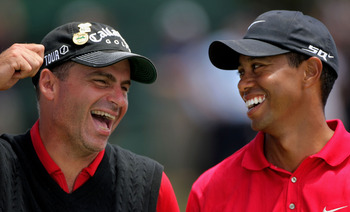 SAN DIEGO - JUNE 16:  Tiger Woods (R), champion, and Rocco Mediate (L), runner up, share a moment on the 18th green during the trophy presentation after the playoff round of the 108th U.S. Open at the Torrey Pines Golf Course (South Course) on June 16, 20