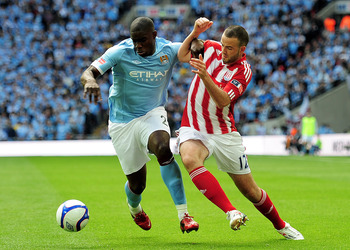 LONDON, ENGLAND - MAY 14: Micah Richards (L) of Manchester City holds off Marc Wilson (R) of Stoke City during the FA Cup sponsored by E.ON Final match between Manchester City and Stoke City at Wembley Stadium on May 14, 2011 in London, England. (Photo by