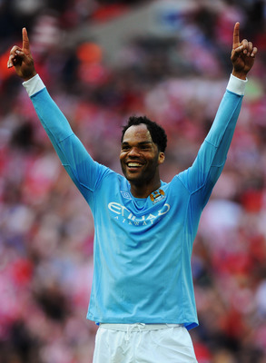 LONDON, ENGLAND - MAY 14:  Joleon Lescott of Manchester City celebrates at the final whistle as his team win the FA Cup sponsored by E.ON Final match between Manchester City and Stoke City at Wembley Stadium on May 14, 2011 in London, England.  (Photo by