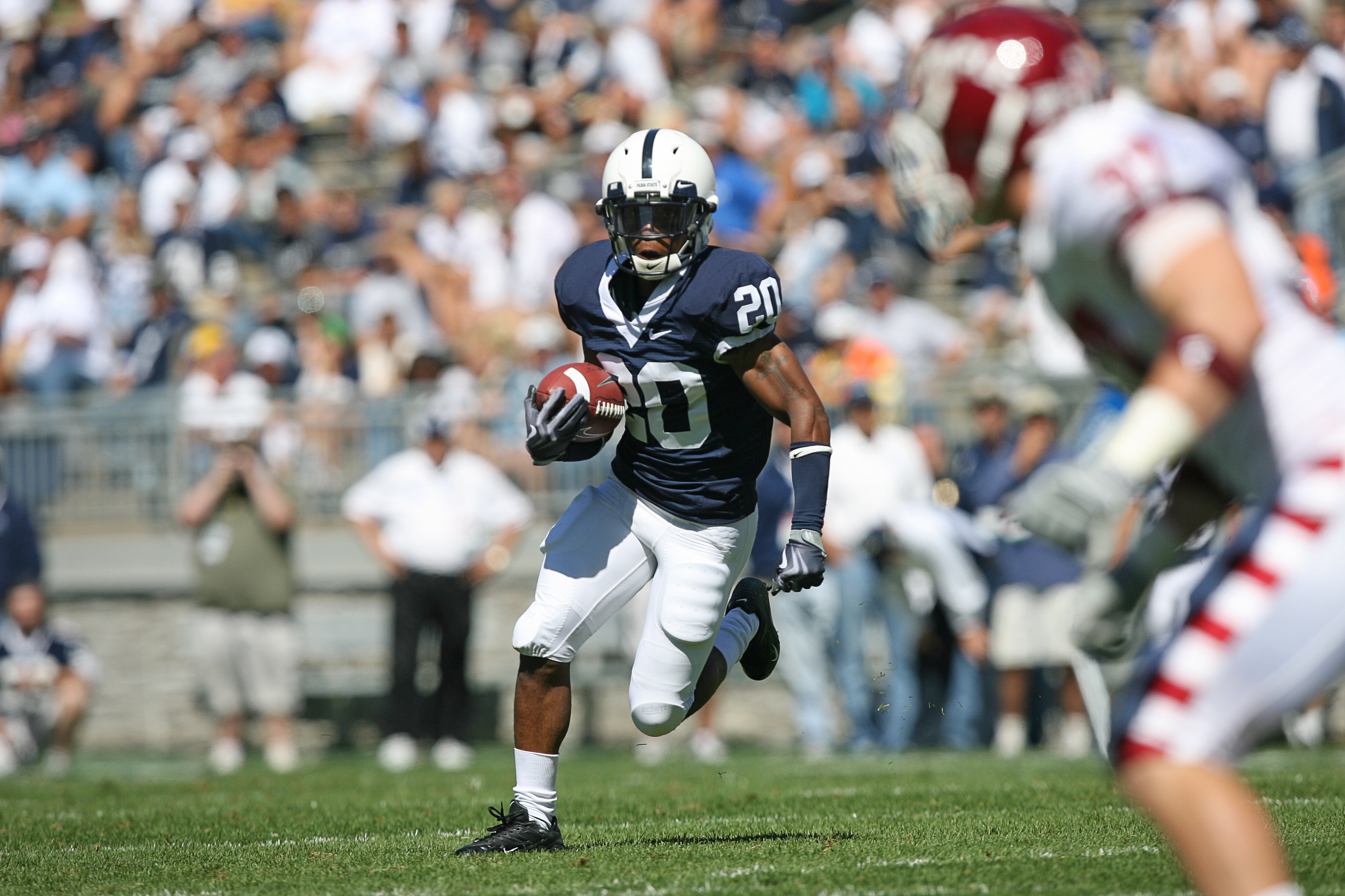 STATE COLLEGE, PA - SEPTEMBER 19: Wide receiver Devon Smith #20 of the Penn State Nittany Lions runs with the ball during a game against the Temple Owls on September 19, 2009 at Beaver Stadium in State College, Pennsylvania. (Photo by Hunter Martin/Getty