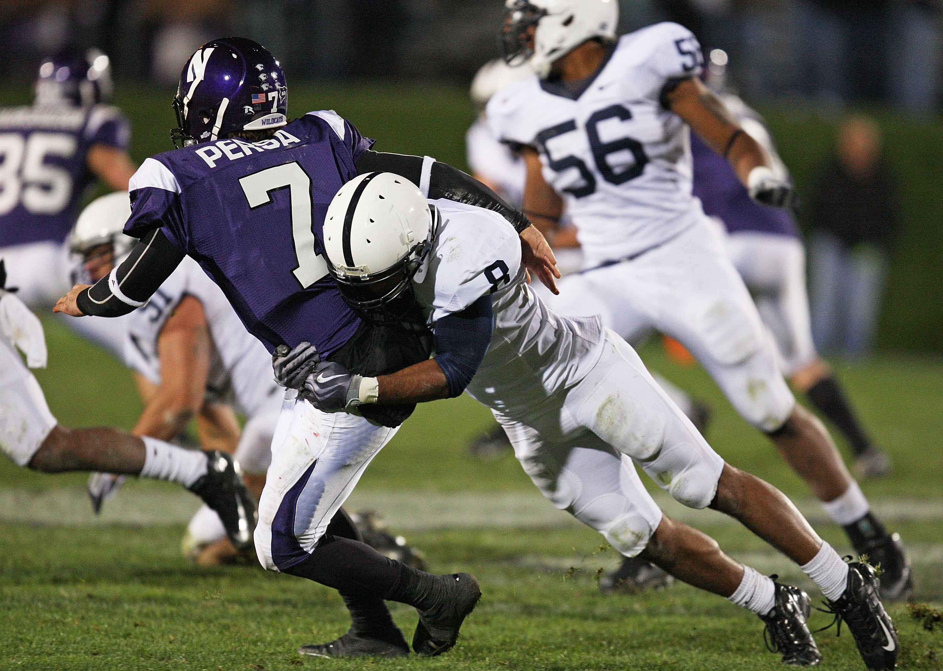 EVANSTON, IL - OCTOBER 31: Dan Persa #7 of the Northwestern Wildcats is hit by D'Anton Lynn #8 of the Penn State Nittany Lions at Ryan Field on October 31, 2009 in Evanston, Illinois. Penn State defeated Northwestern 34-13. (Photo by Jonathan Daniel/Getty