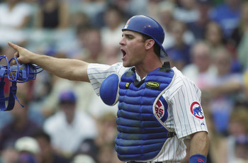 CHICAGO - AUGUST 28:  Catcher Todd Hundley #9 of the Chicago Cubs calls out to his team against the Milwaukee Brewers on August 28, 2001 at Wrigley Field in Chicago, Illinois.  The Brewers defeated the Cubs 8-1.  (Photo by Jonathan Daniel/Getty Images)