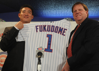CHICAGO - DECEMBER 19:  Chicago Cubs general manager Jim Hendry (R) introduces Japanese Baseball player Kosuke Fukudome #1 (L) as their new outfielder at Wrigley Field December 19, 2007 in Chicago, Illinois.  (Photo by David Blanks/Getty Images)