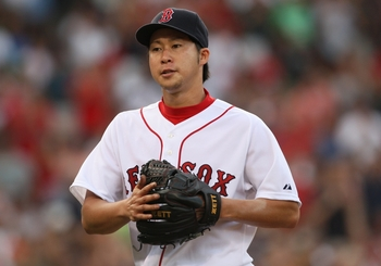 BOSTON - AUGUST 22:  Junichi Tazawa #63 of the Boston Red Sox walks off the mound during the game against the New York Yankees at Fenway Park on August 22, 2009 in Boston, Massachusetts. (Photo by Jim Rogash/Getty Images)