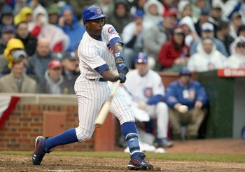 CHICAGO - MARCH 31: Alfonso Soriano #12 of the Chicago Cubs swings at the pitch against the Milwaukee Brewers during the Opening Day game on March 31, 2008 at Wrigley Field in Chicago, Illinois. (Photo by Jonathan Daniel/Getty Images)
