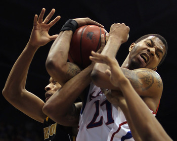 LAWRENCE, KS - FEBRUARY 07:  Markieff Morris #21 of the Kansas Jayhawks shoots as Laurence Bowers #21 of the Missouri Tigers defends during the game on February 5, 2011 at Allen Fieldhouse in Lawrence, Kansas.  (Photo by Jamie Squire/Getty Images)