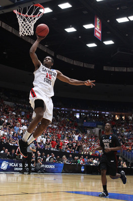 TUCSON, AZ - MARCH 19:  Kawhi Leonard #15 of the San Diego State Aztecs shoots past Scootie Randall #33 of the Temple Owls during the third round of the 2011 NCAA men's basketball tournament at McKale Center on March 19, 2011 in Tucson, Arizona.  (Photo b