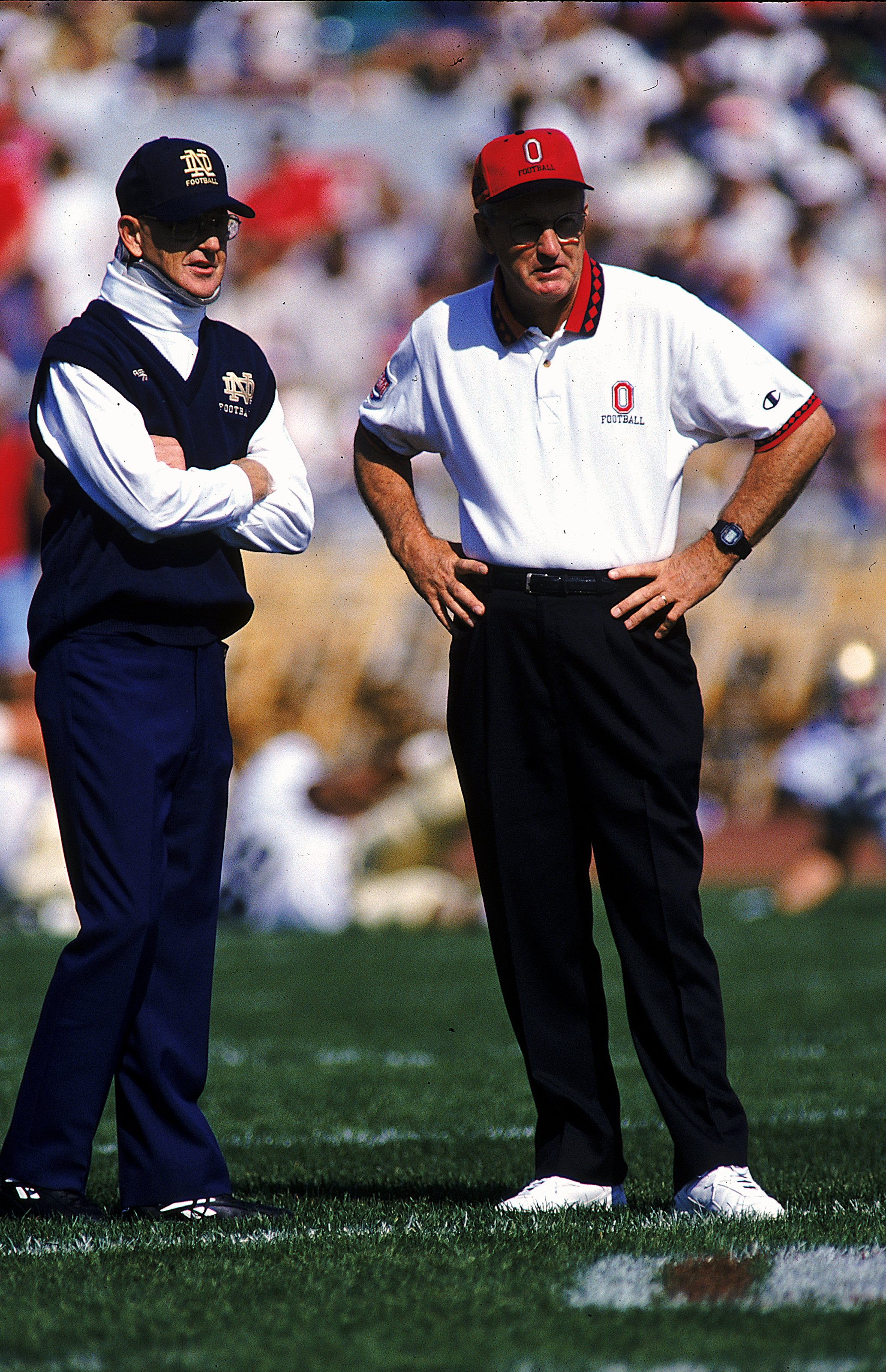 30 Sep 1995: Head coach Lou Holtz of the Notre Dame Fighting Irish stands with Head coach John Cooper of the Ohio State Buckeyes at the Ohio Stadium in Columbus, Ohio. The Buckeyes defeated the Fighting Irish 45-26. Mandatory Credit: Andy Lyons  /Allsport