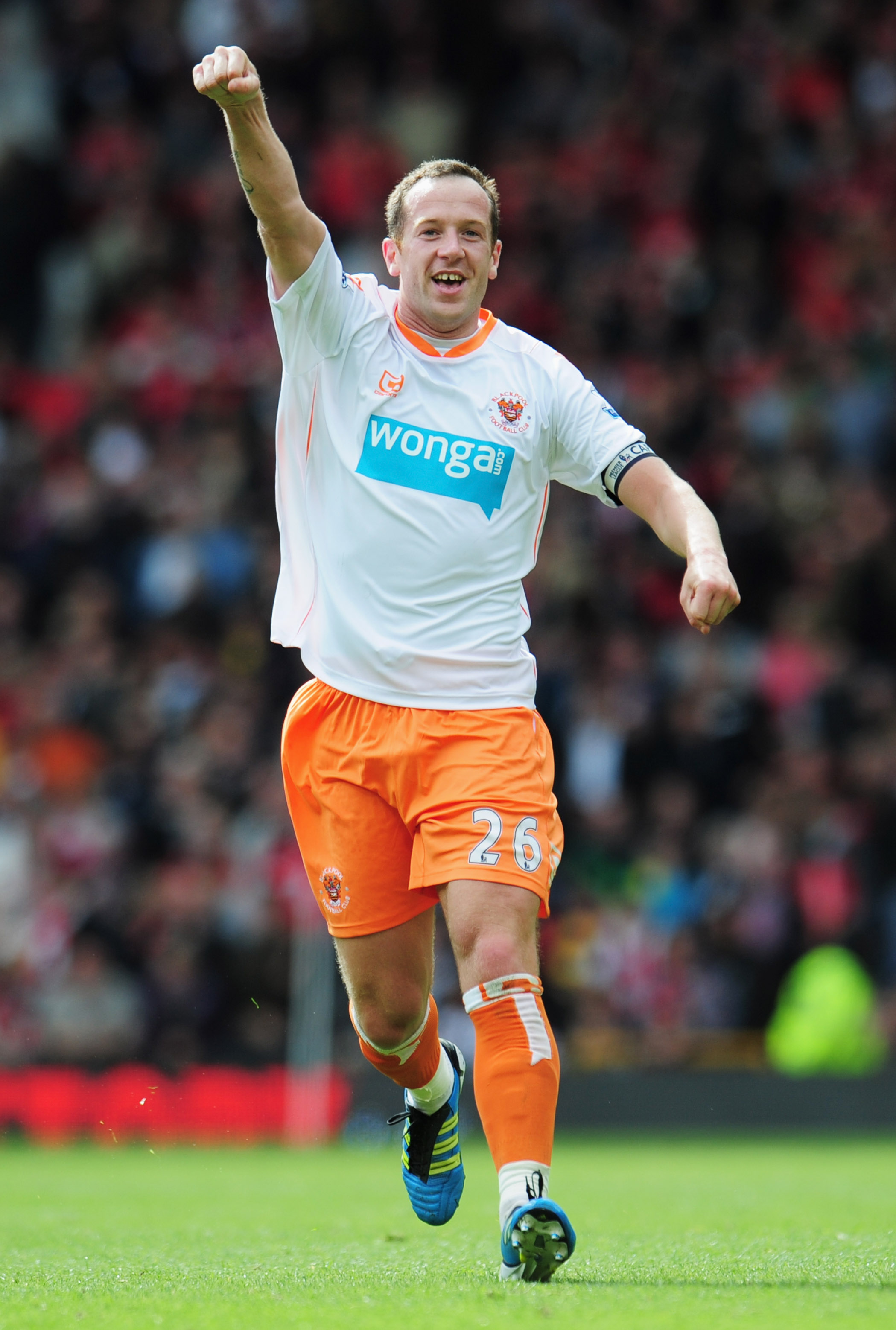 MANCHESTER, ENGLAND - MAY 22:  Charlie Adam of Blackpool celebrates as scores their first goal from a free kick during the Barclays Premier League match between Manchester United and Blackpool at Old Trafford on May 22, 2011 in Manchester, England.  (Phot